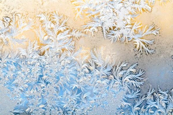 Морозні візерунки на склі
